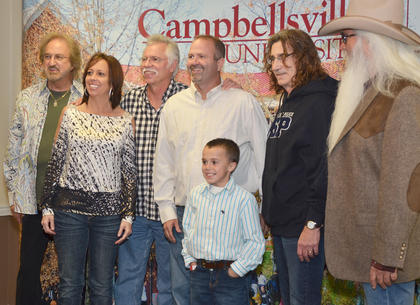 Campbellsville residents Scott, Farrah and Chase Hord pose for a photo with The Oak Ridge Boys during a meet and greet before Monday's concert.