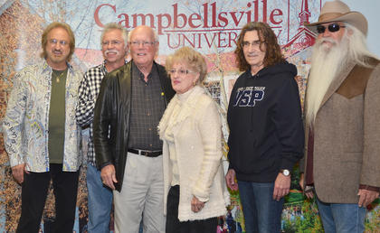 Campbellsville residents Barry and Margaret Bertram pose for a photo with The Oak Ridge Boys during a meet and greet before Monday's concert.