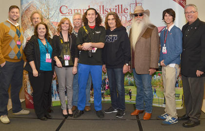 Campbellsville University students and staff members pose for a photo with The Oak Ridge Boys during a meet and greet before Monday's concert.