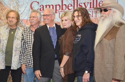 Campbellsville residents Larry and Beverly Noe pose for a photo with The Oak Ridge Boys during a meet and greet before Monday's concert.