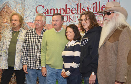 Campbellsville residents J. Paul and Carlene Newton pose for a photo with The Oak Ridge Boys during a meet and greet before Monday's concert.