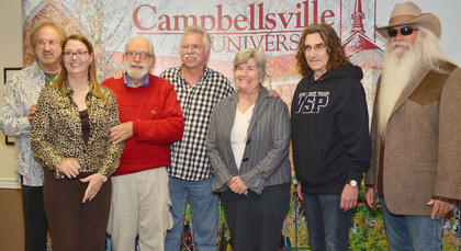 Campbellsville residents, from left, Dr. Lora Sztendera and Dan and Virginia Flanagan pose for a photo with The Oak Ridge Boys during a meet and greet before Monday's concert.
