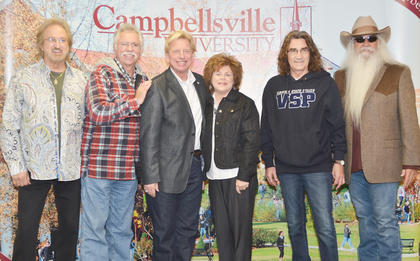 Dr. Ted and Sheri Taylor pose for a photo with The Oak Ridge Boys during a meet and greet before Monday's concert.