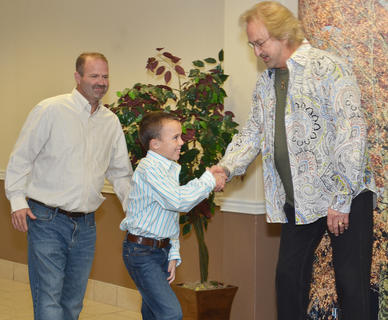 Scott Hord and his son, Chase, meet Duane Allen of The Oak Ridge boys during a meet and greet before Monday's concert.