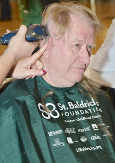 Melvin Skaggs gets his head shaved.