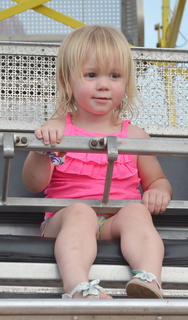 Lydia Whitley, 1 1/2, of Campbellsville, wasn't tall enough for the big Ferris wheel, but enjoyed the small one instead.