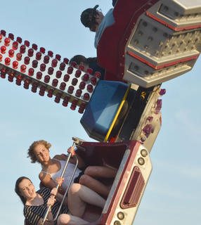 Fairgoers lined up to ride the fast rides at the fair.