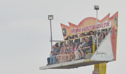 Fairgoers are high in the sky on one of many rides at the fair.