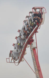 Fairgoers are upside down on this ride at the fair.