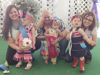 Winners of the 1-year-old girls category in the Miss and Mister Toddler Taylor County Fair pageant are, from left, winner Maria Grace Burton, first runner-up Kulie Alexandra Leonardo and second runner-up Kentlee Caroline Keltner.