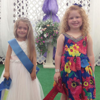 Winners in the 4-year-old girls category in the Miss and Mister Toddler Taylor County Fair pageant are, from left, winner Akeia Davis and first runner-up Saylor Alyse Wilson.