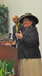 Minister Pamela Young Buford welcomes guests to the Dr. Martin Luther King Jr. reception on Saturday night.