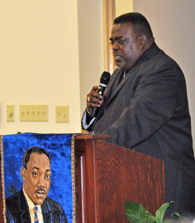 The Rev. George Nelson introduces guest speaker the Rev. Bernard Crayton at the MLK reception on Saturday night.