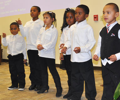 The Community Children's Choir sings uplifting songs for guests at the MLK reception Saturday night.