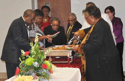 Guests fill up their plates during Saturday night's MLK reception.
