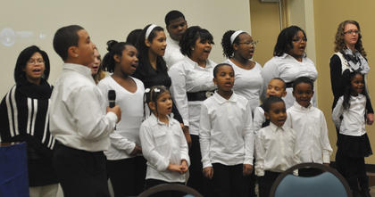 The Community Youth and Children's choirs sing inspirational hymns for guests at the MLK reception Saturday night.