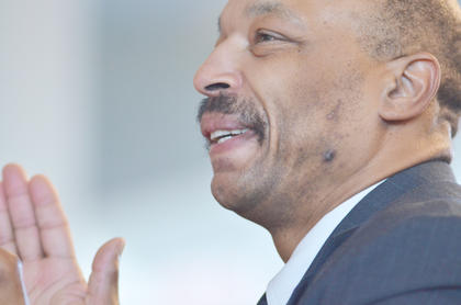 The Rev. James I. Buford smiles as he sings along with the Bethel AME Church Choir at this year's MLK worship service.