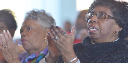 Jean Allen, at left, and Phyllis Mattingly clap as they sing with the Bethel AME Church Choir at this year's MLK worship service.