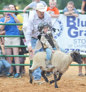 Dozens of children participated in the mutton busting competition on Tuesday night. The fair offered the event for the first time last year and it has proven popular.
