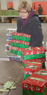Emma Revis carries OCC boxes for sorting.