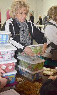 Beverly Janes places rubber bands around OCC boxes.