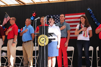 SSG Charis Strange performs the National Anthem during Friday morning's opening ceremony to kick off the Fourth of July Celebration.