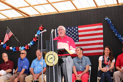 Taylor County Judge/Executive Eddie Rogers lets the crowd know he is proud to be an American during Friday morning's opening ceremony to kick off the Fourth of July Celebration.