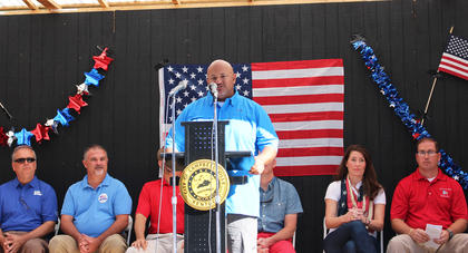 General Manager of Amazon Fulfillment Carlos Delagarza, also a veteran, welcomes the crowd to the Fourth of July Celebration.