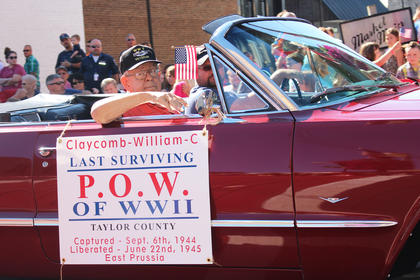 Conrad Claycomb, Taylor County's last surviving World War II prisoner of war, rides in the parade.