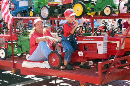This little boy shows that a love for tractors begins at an early age.