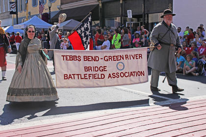 Tebbs Bend-Green River Bridge Battlefield Association members offer a glimpse of history as they walk in the parade.