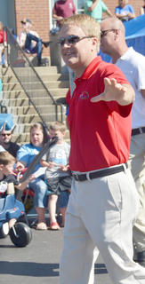 James Comer, Kentucky's commissioner of agriculture, waves to the crowd during the Fourth of July parade on Friday morning.