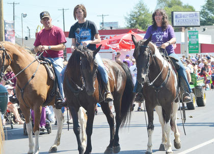 The community's Fourth of July parade on Friday featured many tractors, ATVs and horses, like the ones above.