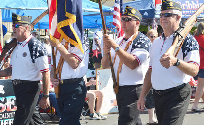 American Legion Post 82 members lead the Fourth of July parade on Friday morning.