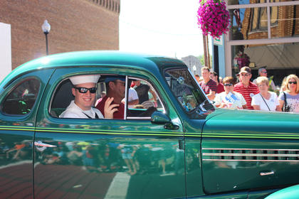 Residents rode in cars and waved to the crowd during Friday's parade.