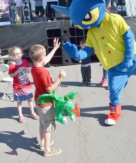 Pete the Cat danced and posed for photos with children on Main Street.