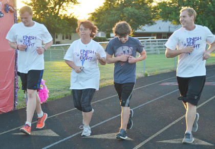 Residents run on the TCHS track.