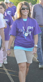 Dana Yates Warren, a cancer survivor, walks a lap.