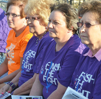 Cancer survivors listen during Friday's opening ceremony.