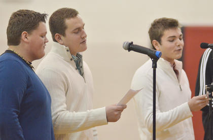 "The sound of Christmas filled the gymnasium. Taylor County Show Choir members performed their holiday showcase on Sunday. They sang songs about Christmas decorations, Rudolph, snow and mistletoe. From left, Blake Allen, Jack Miller, Elijah Myers and Caleb Wigginton, not pictured, sing ""The 12 Days of Christmas,"" with the lyrics re-written to detail their experiences in show choir."