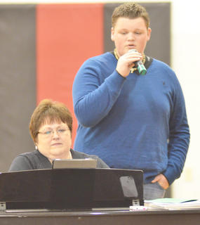 "Blake Allen sings ""White Christmas"" as choir director Lisa Gupton plays piano. Allen's duet partner, Reagan Pollock, isn't pictured."