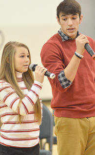 "Gabby Pyles, at left, and Justice Gregory sing ""Mistletoe."""