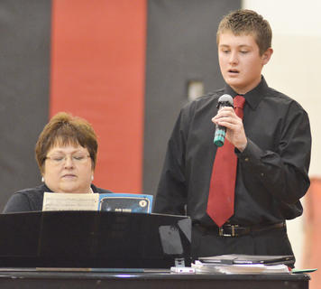 "Cameron Jeffries sings ""Do You Hear What I Hear"" as choir director Lisa Gupton plays piano. Jeffries' duet partner, Brooke Gilpin, isn't pictured."