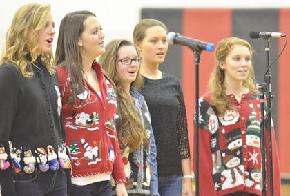 "From left, Kassie Miller, Brittany Speer, Lizzy Cox, Maddie Mason and Madison Lauer sing ""Rudolph the Red-Nosed Reindeer."""