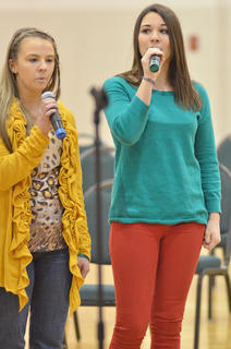 "Hannah Brockman, at left, and Rebekah Ellis sing ""Hallelujah."""
