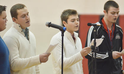 "From left, Blake Allen, Jack Miller, Elijah Myers and Caleb Wigginton sing ""The 12 Days of Christmas,"" with the lyrics re-written to detail their experiences in show choir."