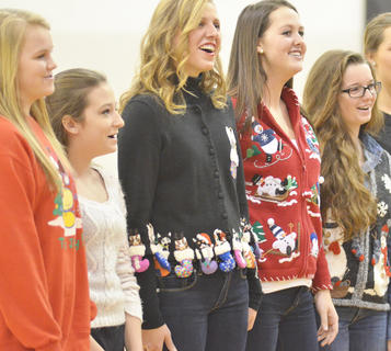 "From left, MaKayla Sabo, Sydney Humphress, Kassie Miller, Brittany Speer and Lizzy Cox sing ""Rudolph, the Red-Nosed Reindeer."""