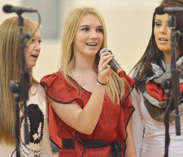 "Taylor Edelen, center, sings ""Christmas (Baby, Please Come Home)"" with fellow show choir members Jessi Allen, at left, and Zoe Lockard."