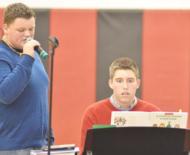 "Blake Allen, at left, sings ""The Christmas Song"" as Grant Cox plays the piano."