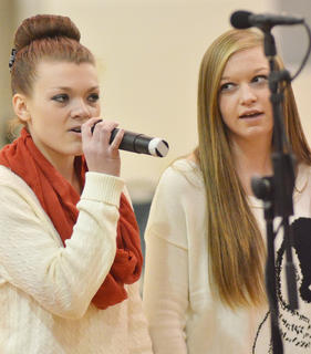 "Tori Cochran, at left, sings ""Christmas (Baby, Please Come Home)."" Jessi Allen is at right."